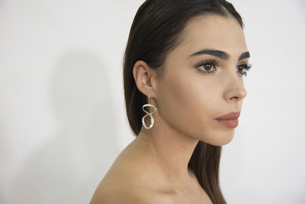 Silver brushed infinity shaped earrings
